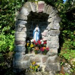 A Statue of the Virgin at the board of the forest