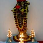 Krishna statue in the back of the hall