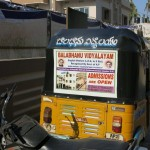 A tuk-tuk with an advertisement of the Balabhanu school