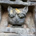 God is also in the cat - a relief above the entrance