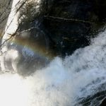 A rainbow over the thundering waters inside the mountain
